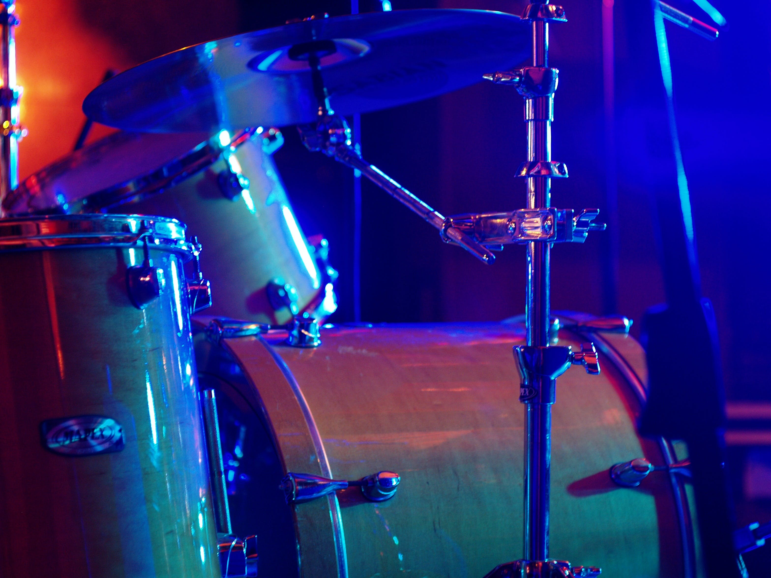 Shallow Focus Photography of Brown Drum Set
