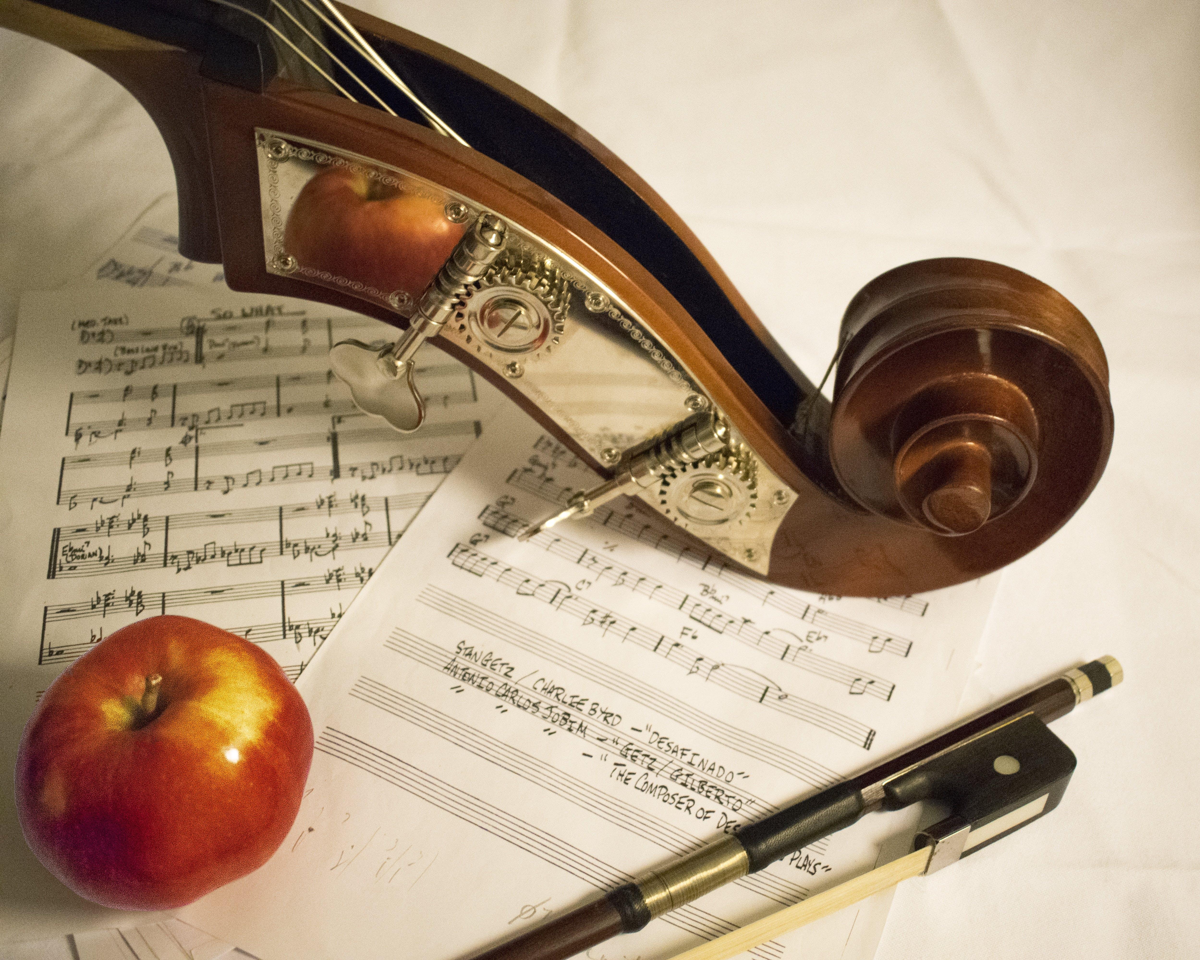 Red Apple Fruit on Music Sheet