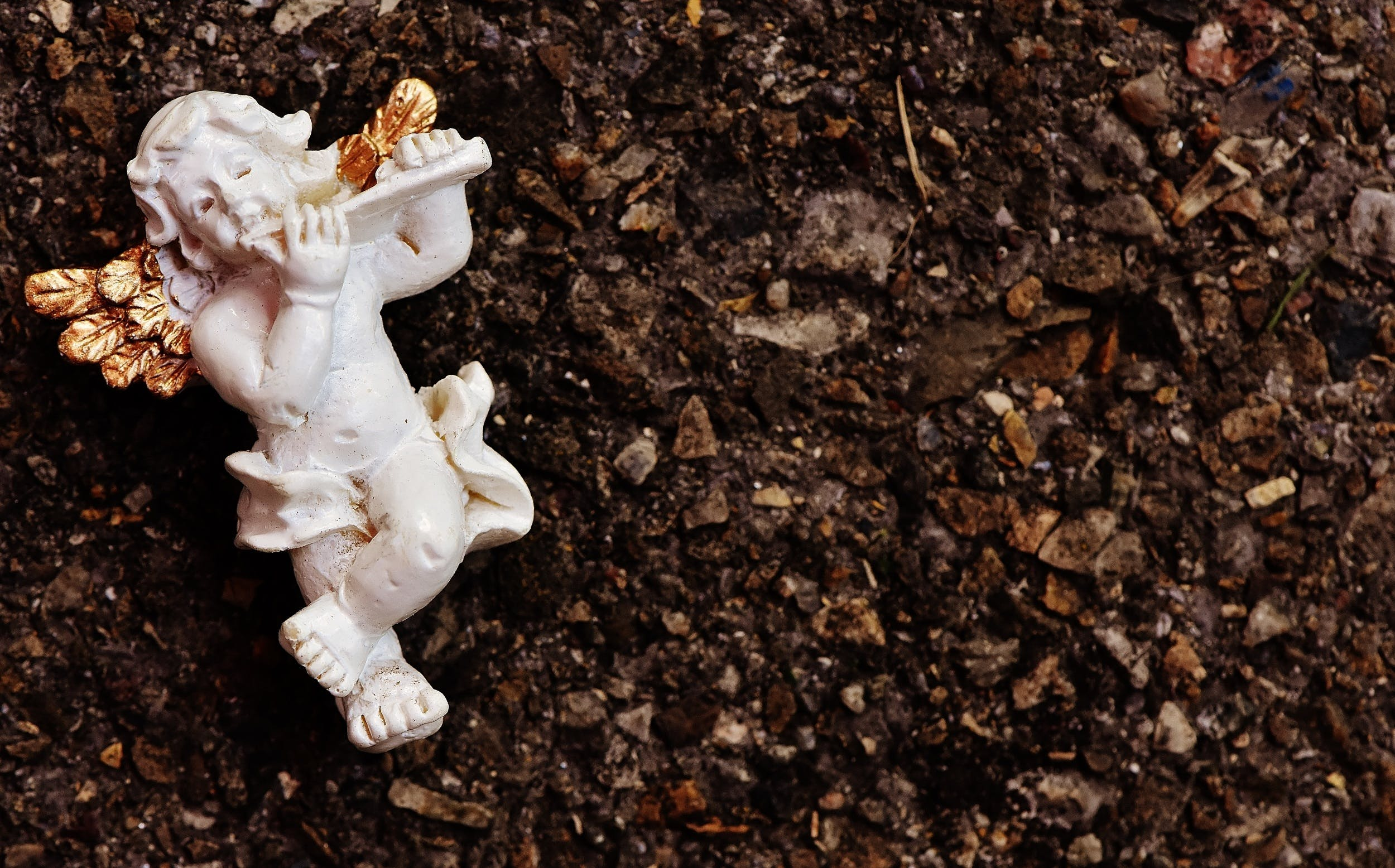White Cherub Playing Flute Ceramic Figurine