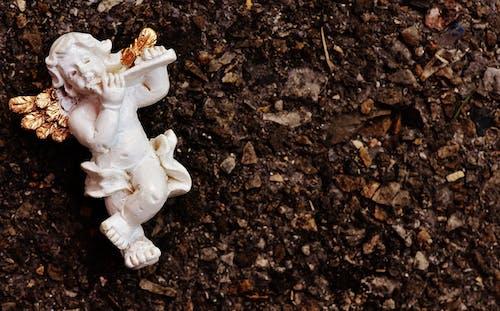 Бесплатное стоковое фото с Ангел, грязный, грязь, земля