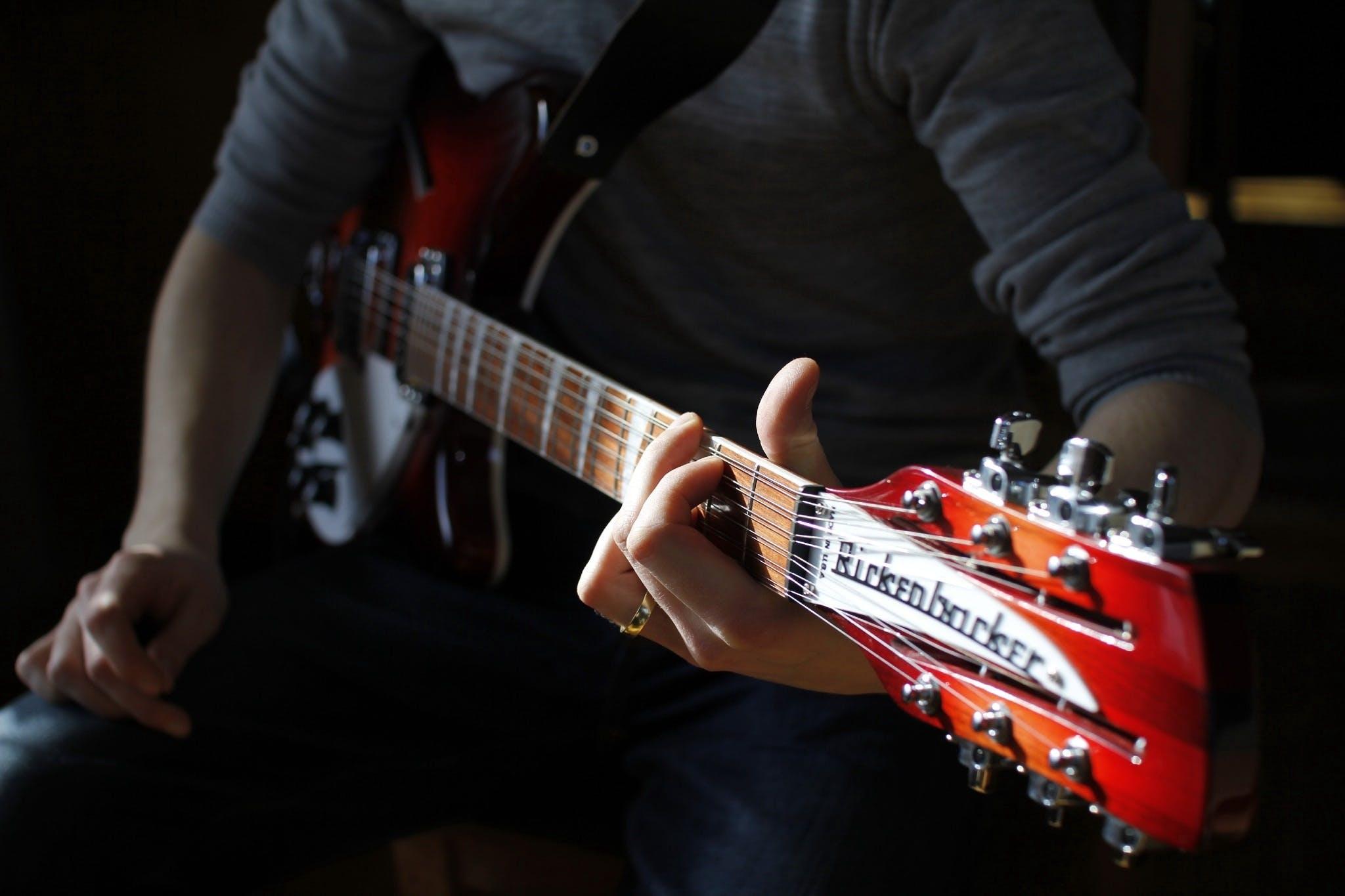 Man Sitting Playing Guitar