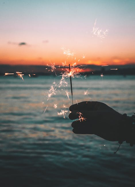 Silhouette of person holding fireworks