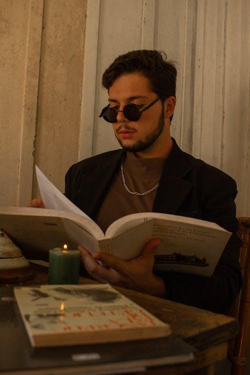 Man Reading Book Inside Room