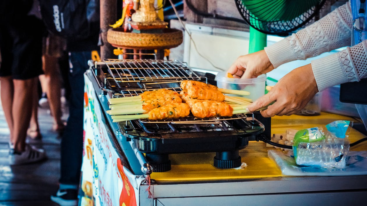 Person Grilling Food