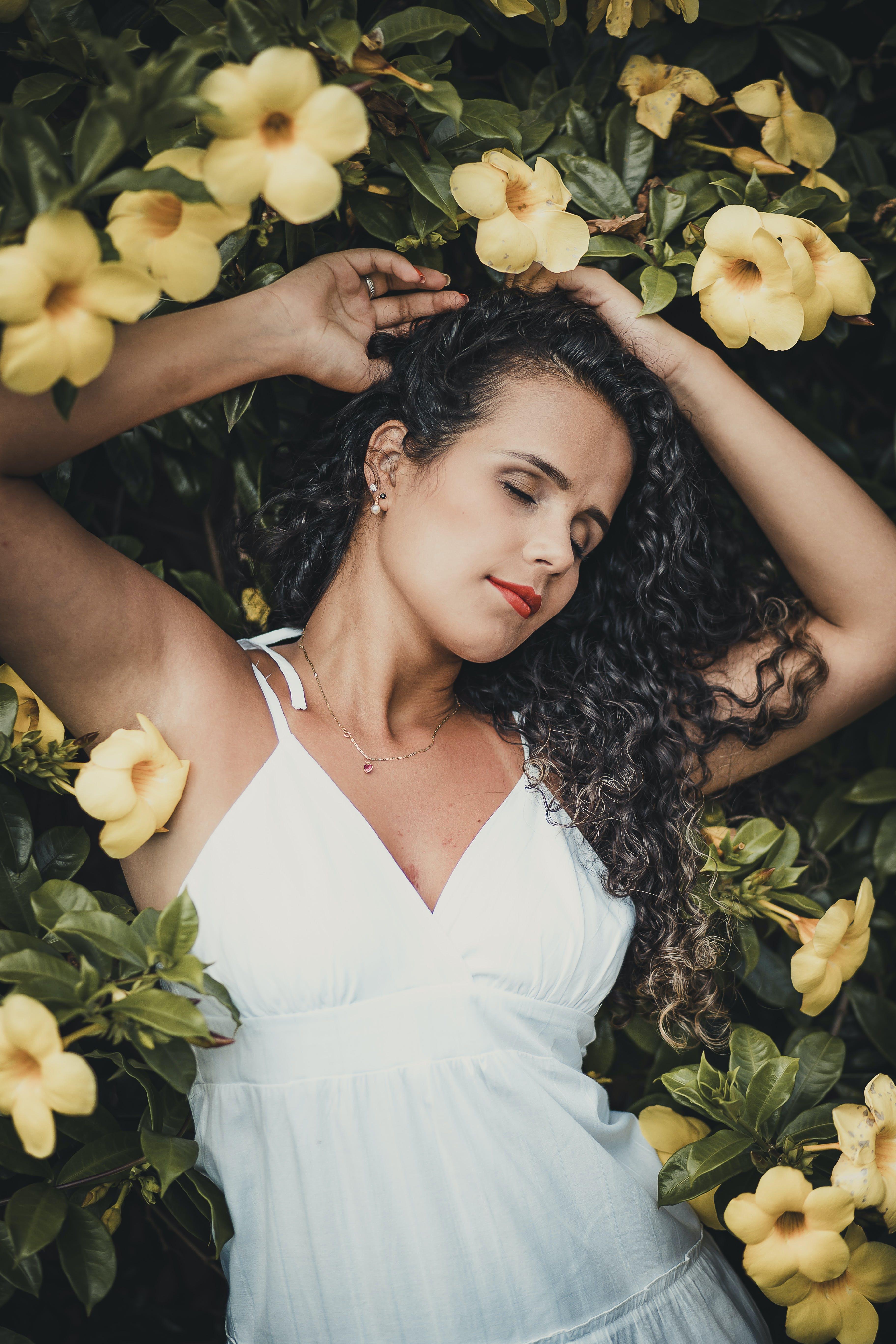 Woman Lying Beside Flowers