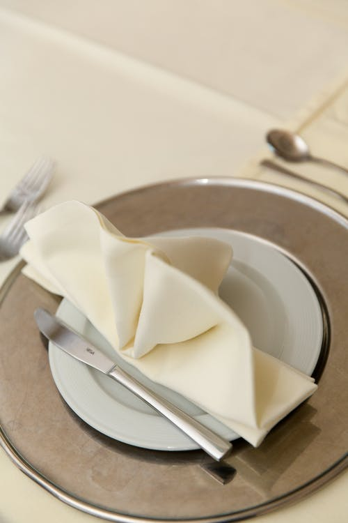 White Tissue Paper on Silver Round Plate