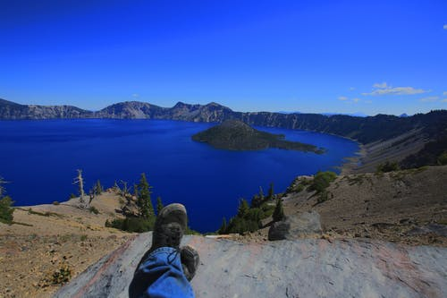 Free stock photo of blue water, Crater Lake, feet up, lake