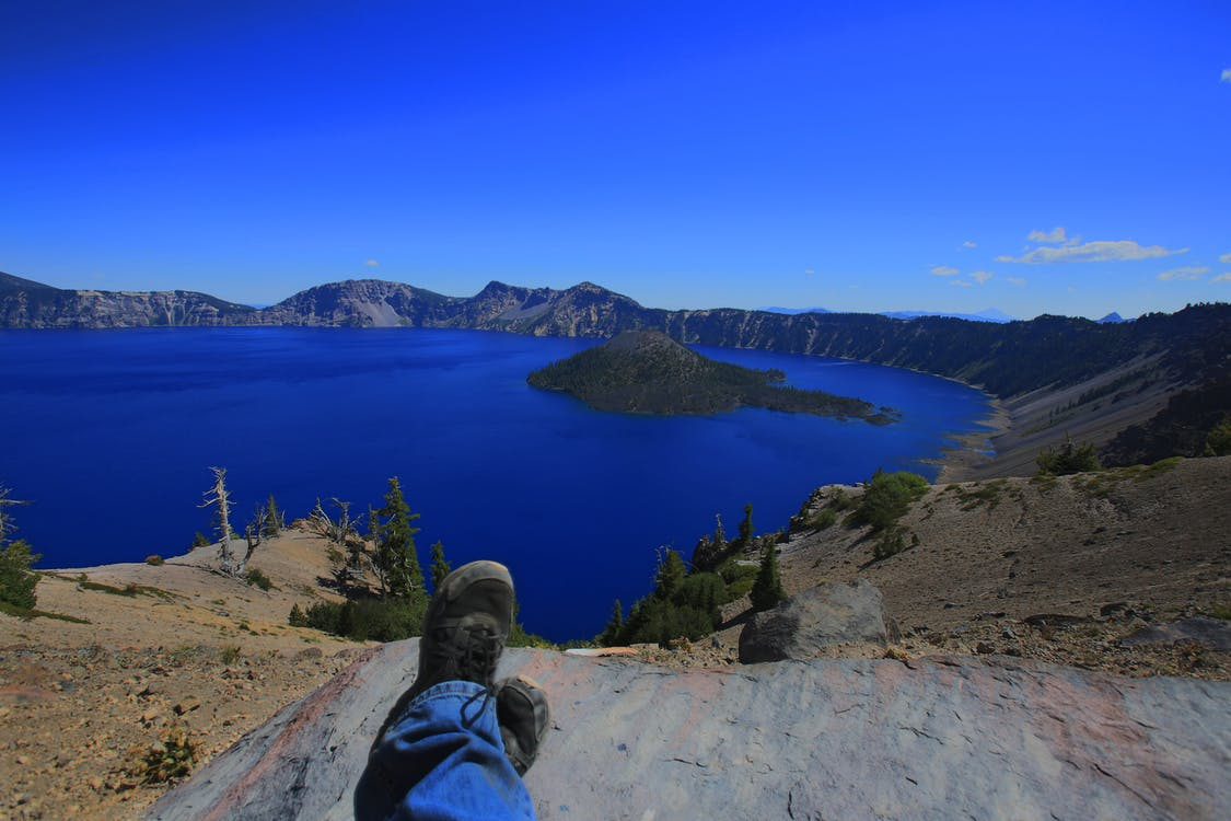 Free stock photo of blue water, crater lake, feet up