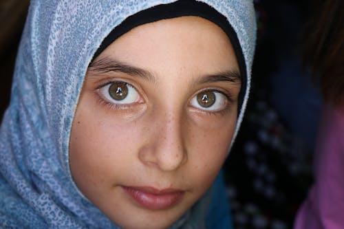 Portrait of Woman Wearing Blue Hijab