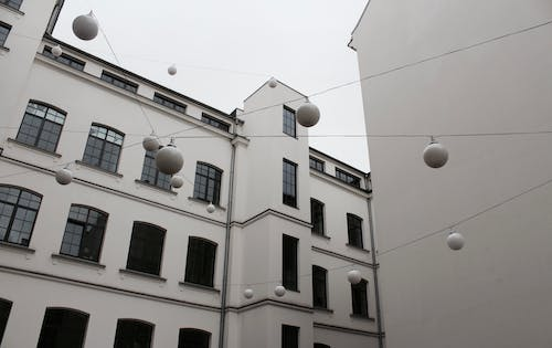 White Hanging Light Balls in Front of White Building