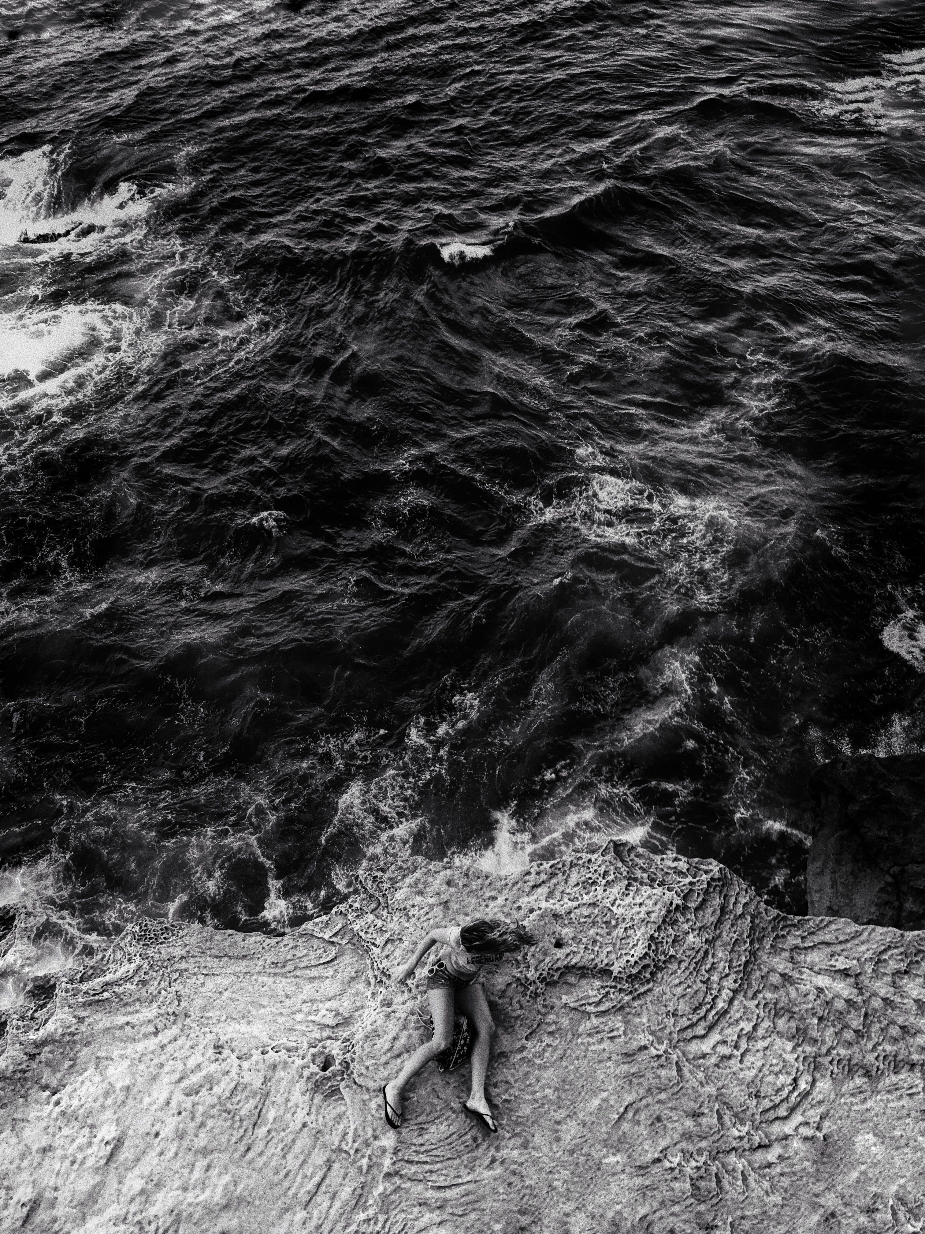 Woman Sitting on Shore