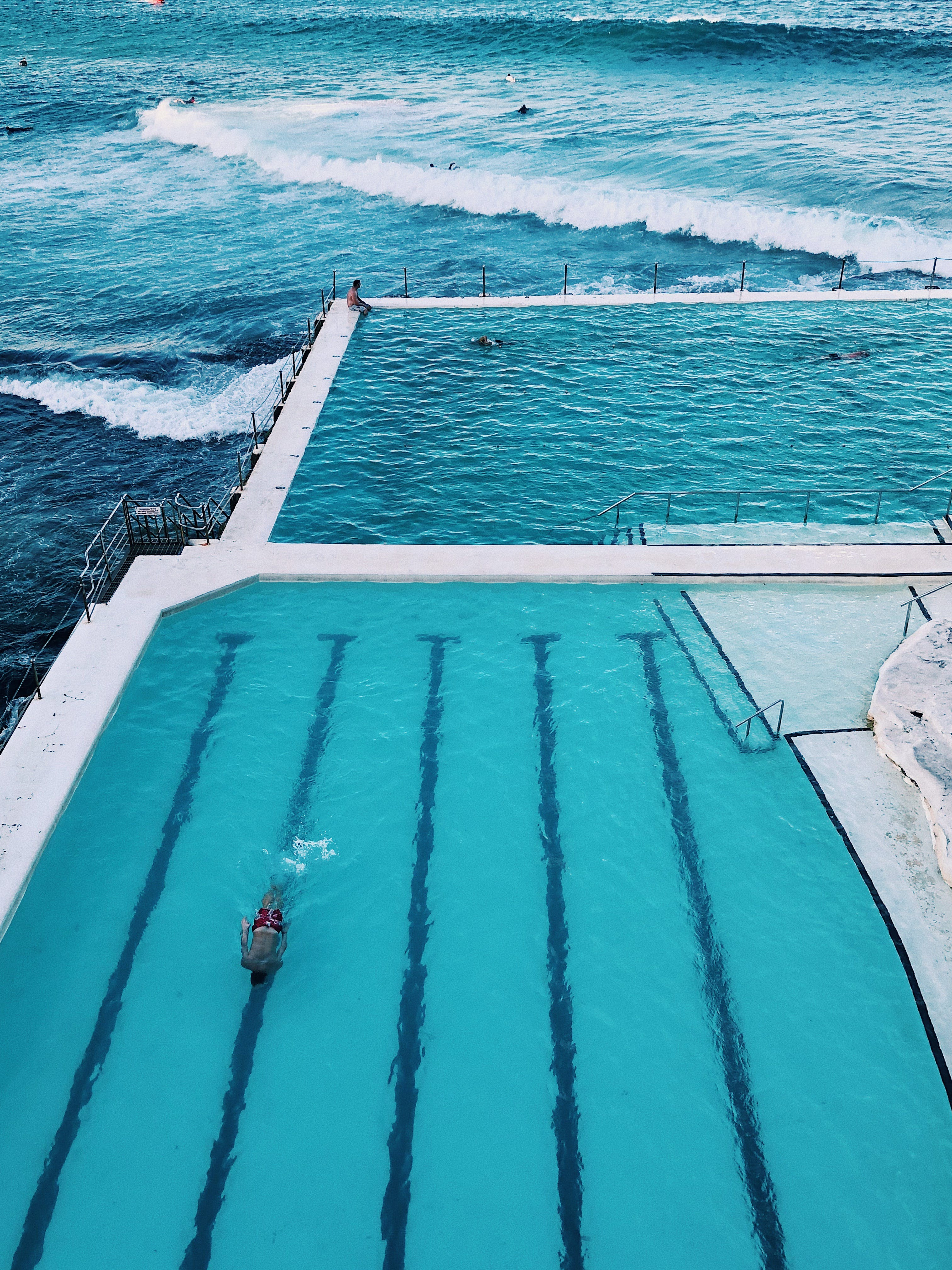 Aerial Photography of Pool and Body of Water
