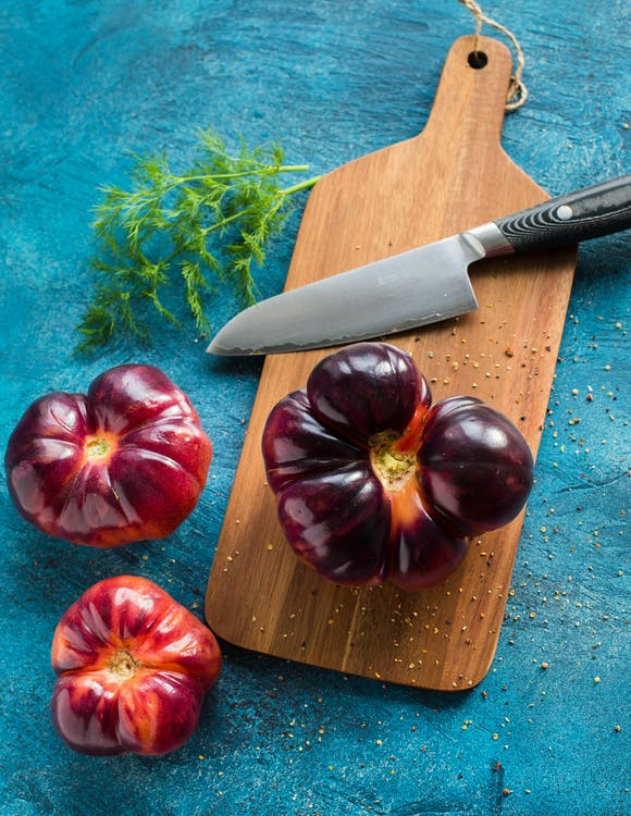 Black Handle Knife With Vegetables
