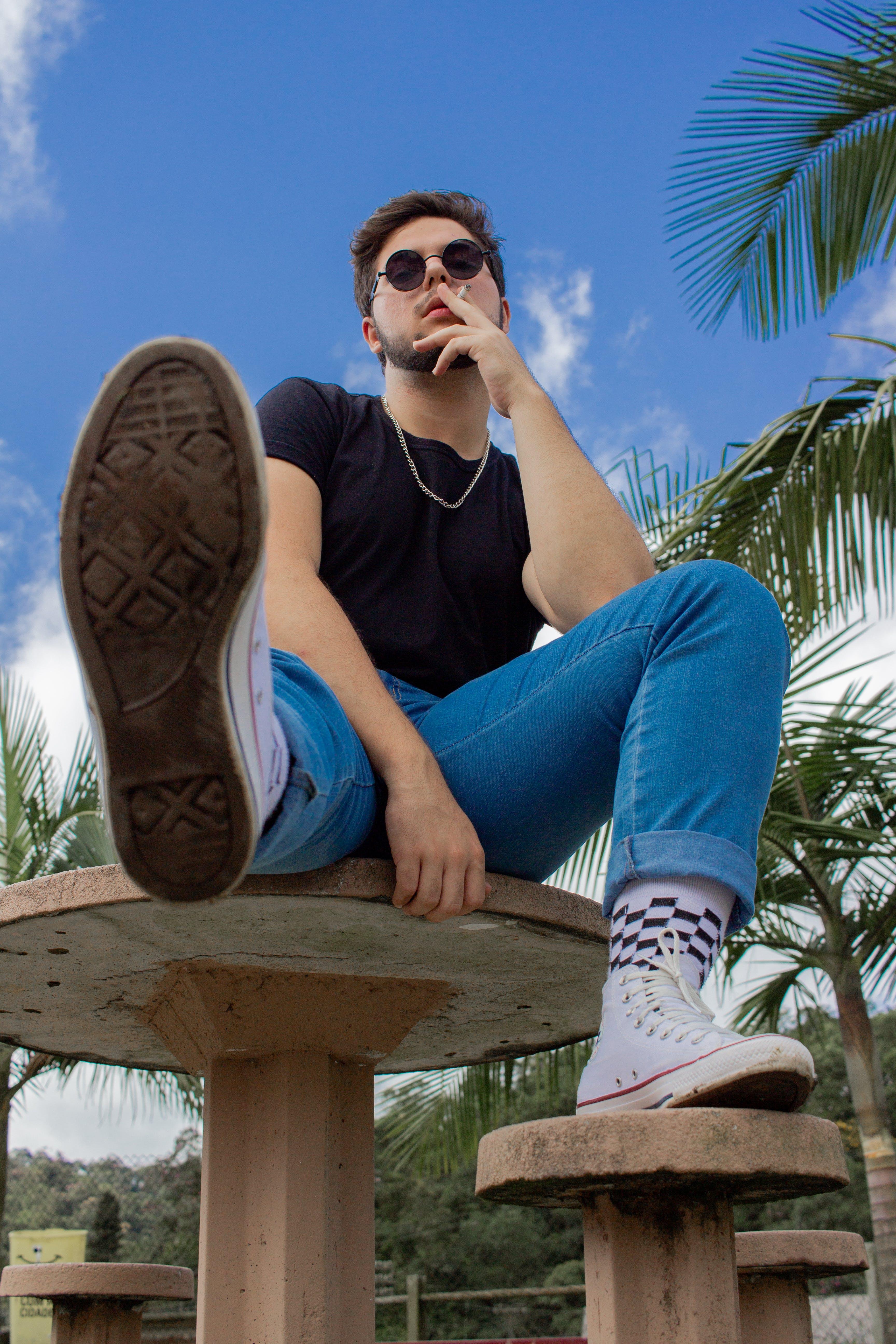 Man Sitting on Concrete Table