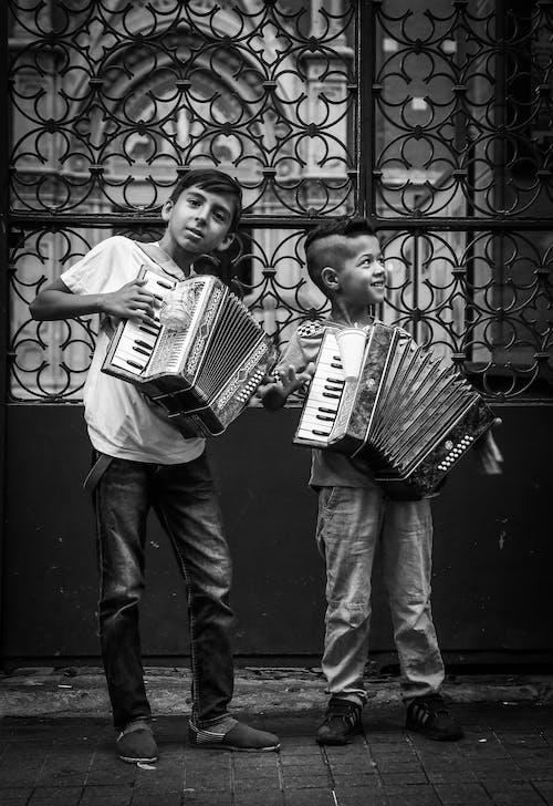 Two Children Playing Electronic Piano