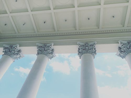 Low-angle Photography of Corinthian-style Columns
