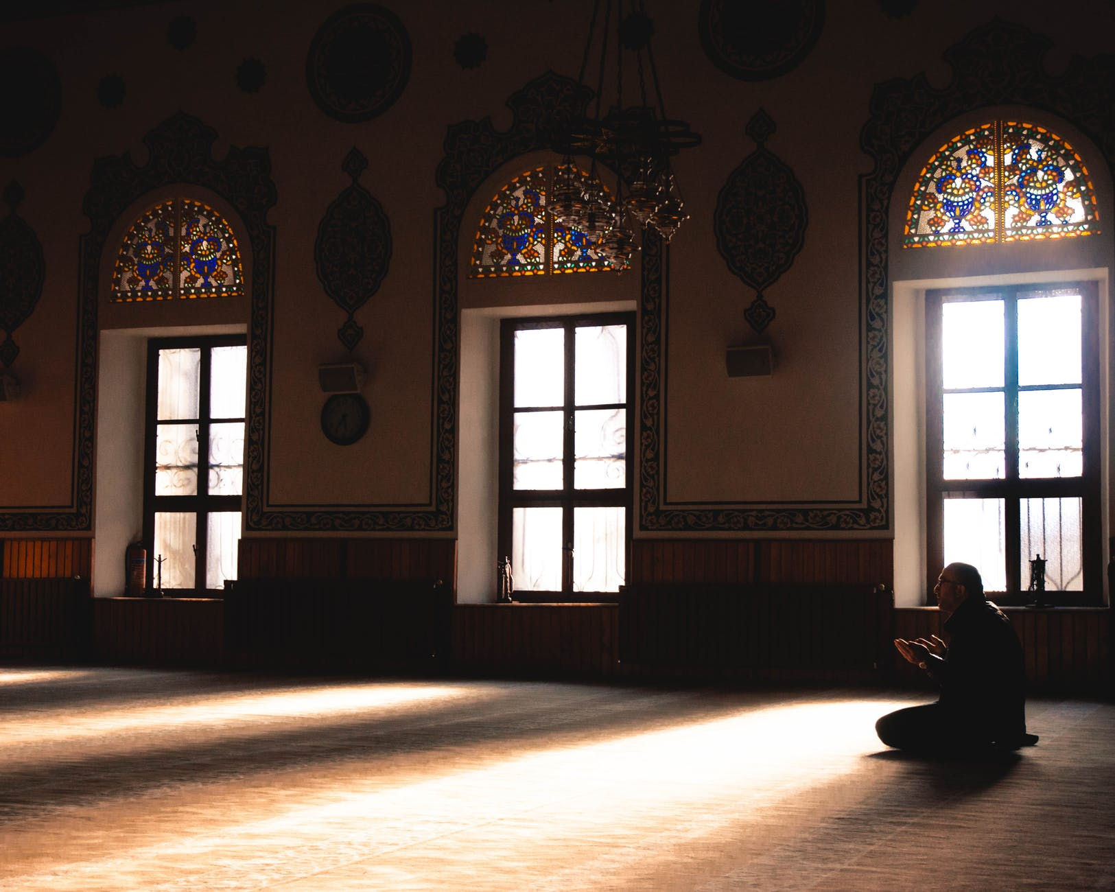 A guy praying inside the mosque