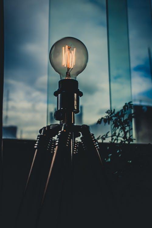 Light Bulb Near Glass Pane Inside Room