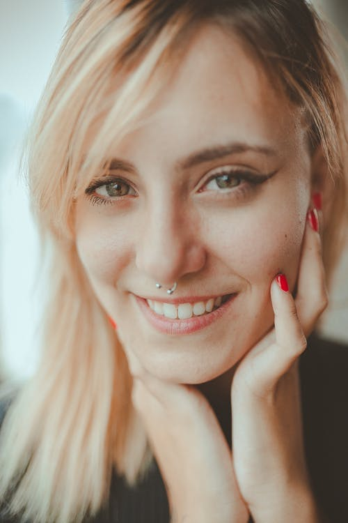 Smiling Woman Wearing Nose Piercing