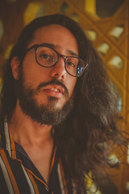 Man With Long Hair Wearing Eyeglasses