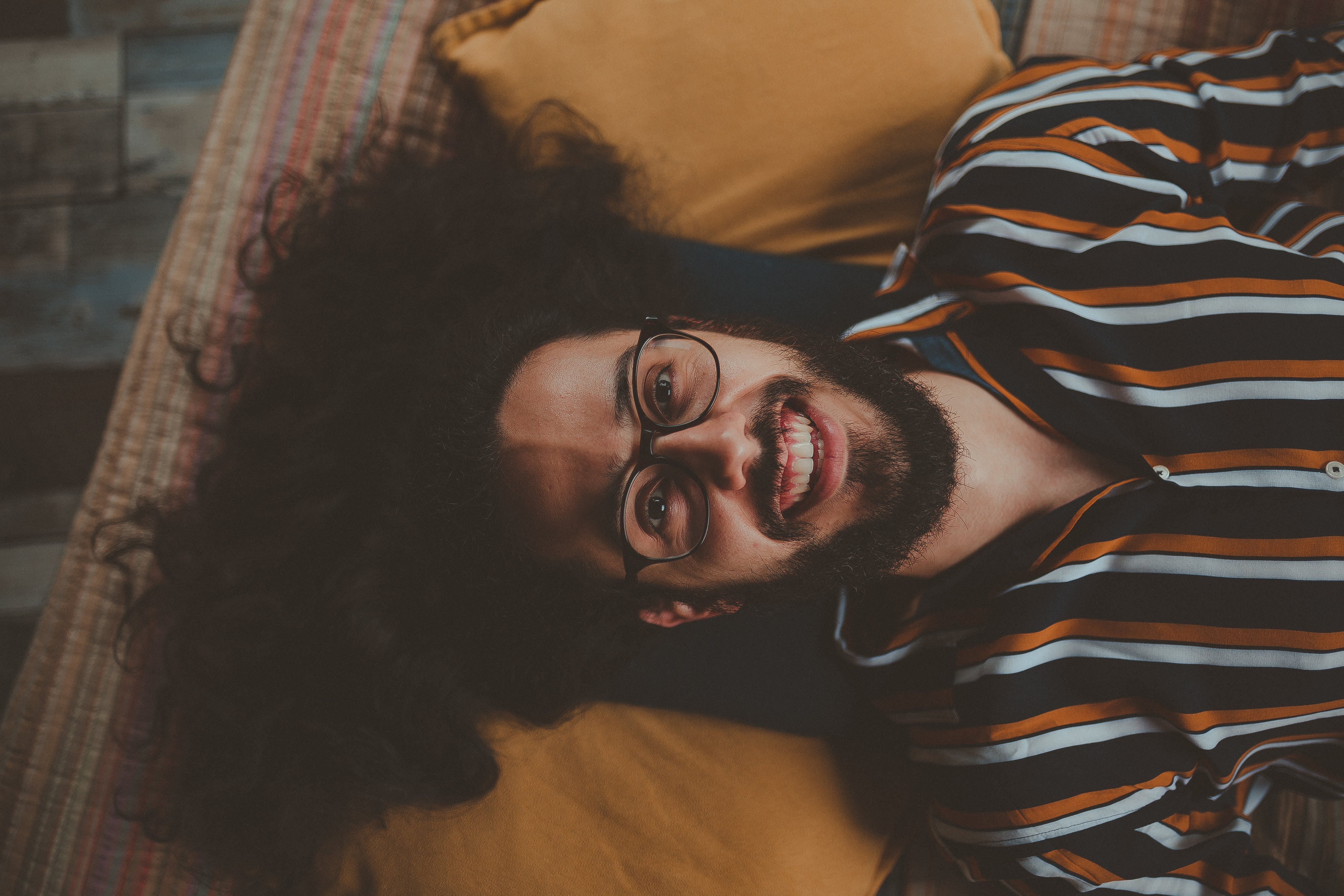 Man Lying on Bed Smiling