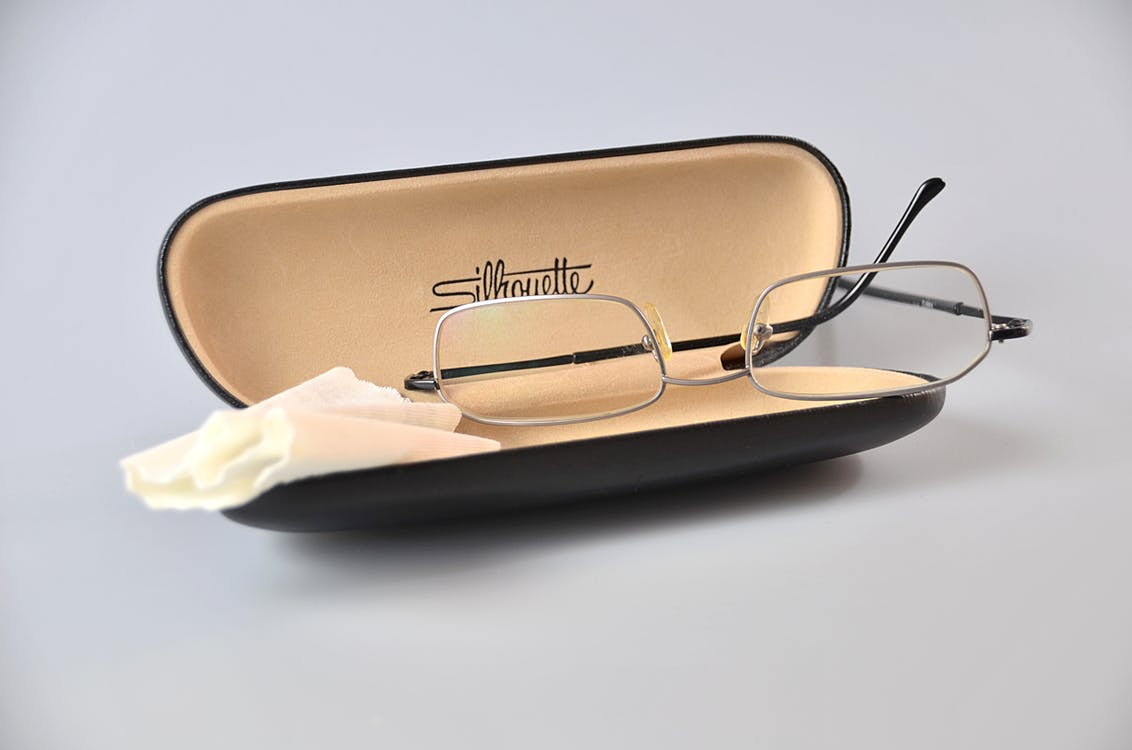 Silver Framed Eyeglasses on Black Eyewear Case