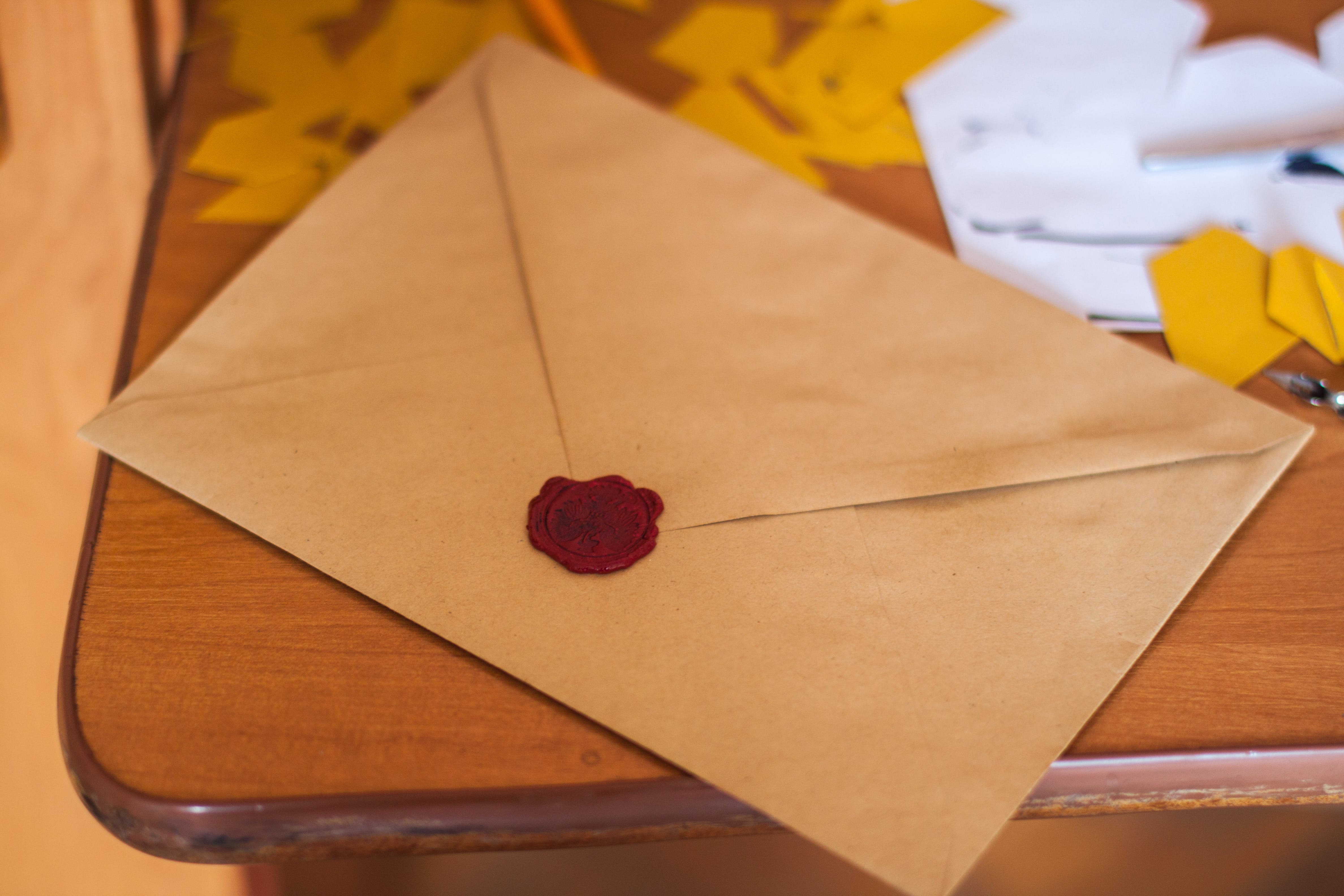 Brown Paper Envelope on Table