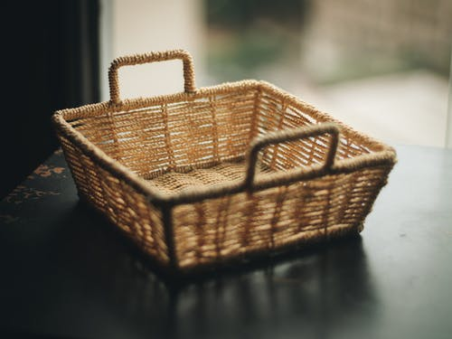 Square Brown Wicker Basket on Table