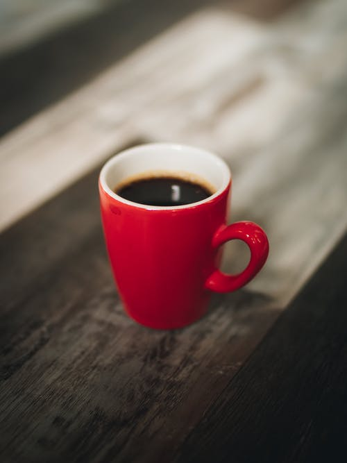 Selective Focus Photography Red Cup of Coffee