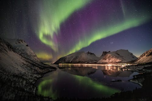 Northern Lights Near Snow-coated Mountains