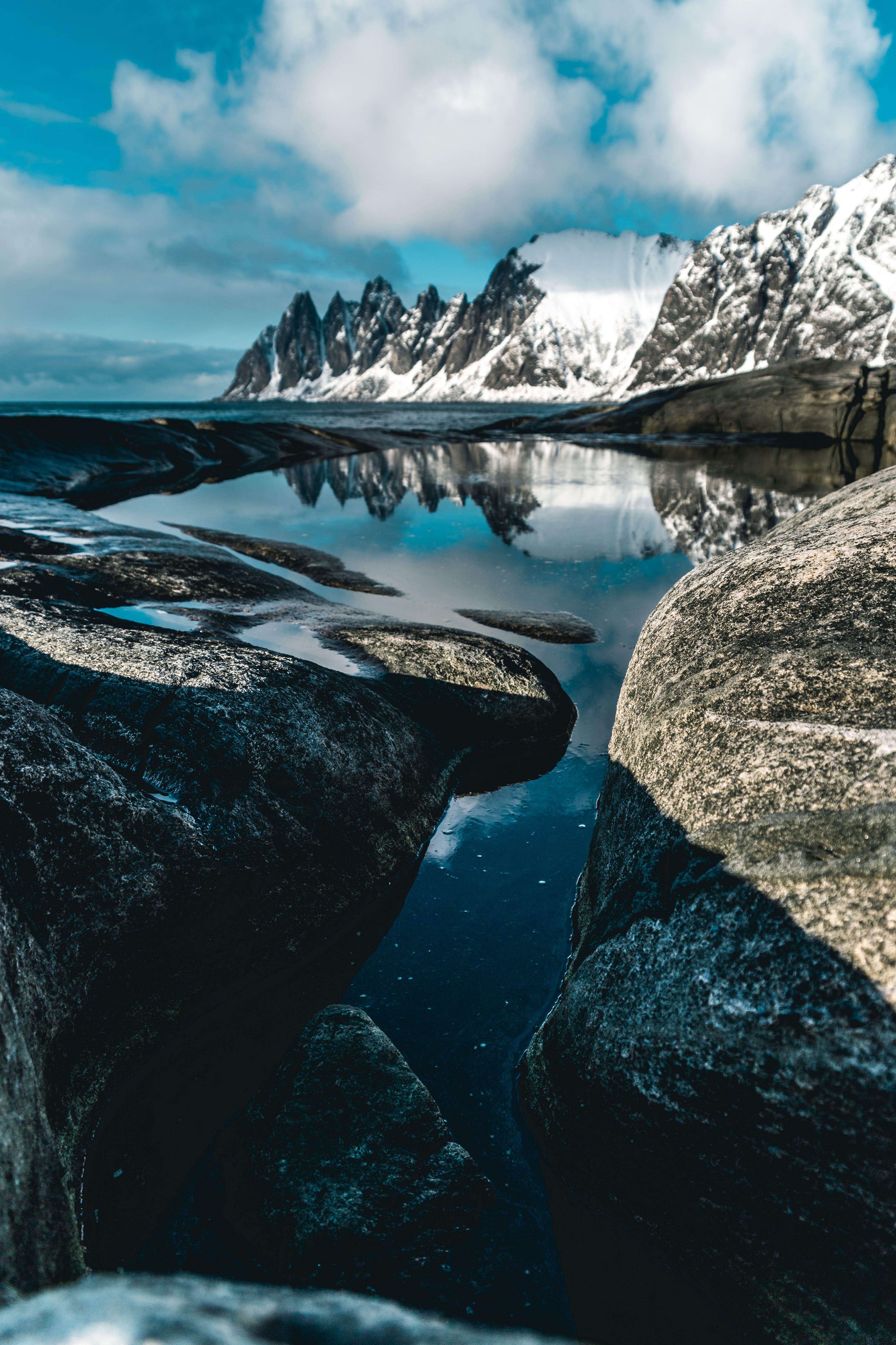 Gratis stockfoto met altitude, bergen, bergketen, bergtop