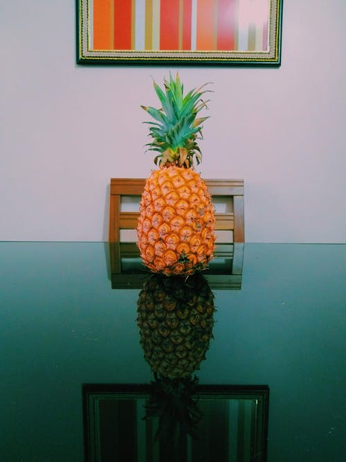 Pineapple on Glass Table