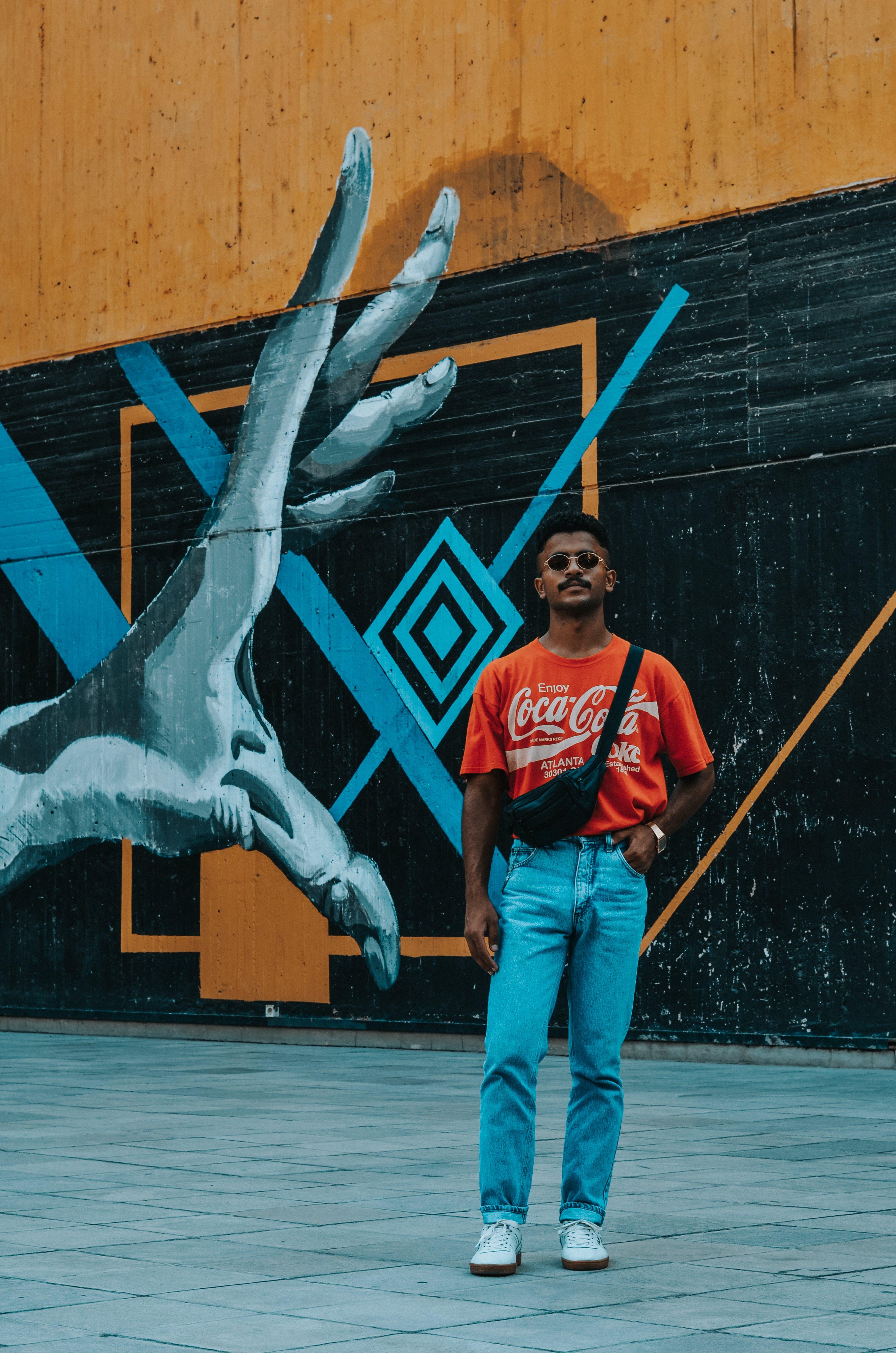 Man Standing Near Mural