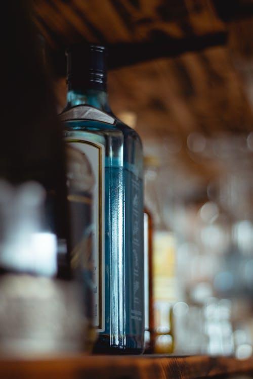 Clear Glass Bottle On Shelf