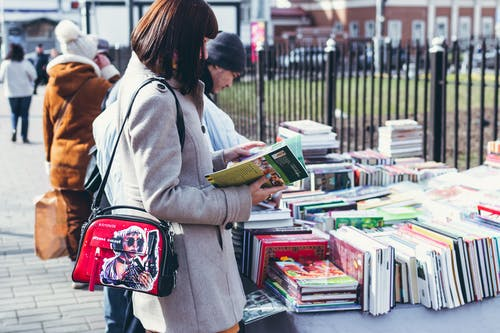 Woman Wearing Coat Holding Book