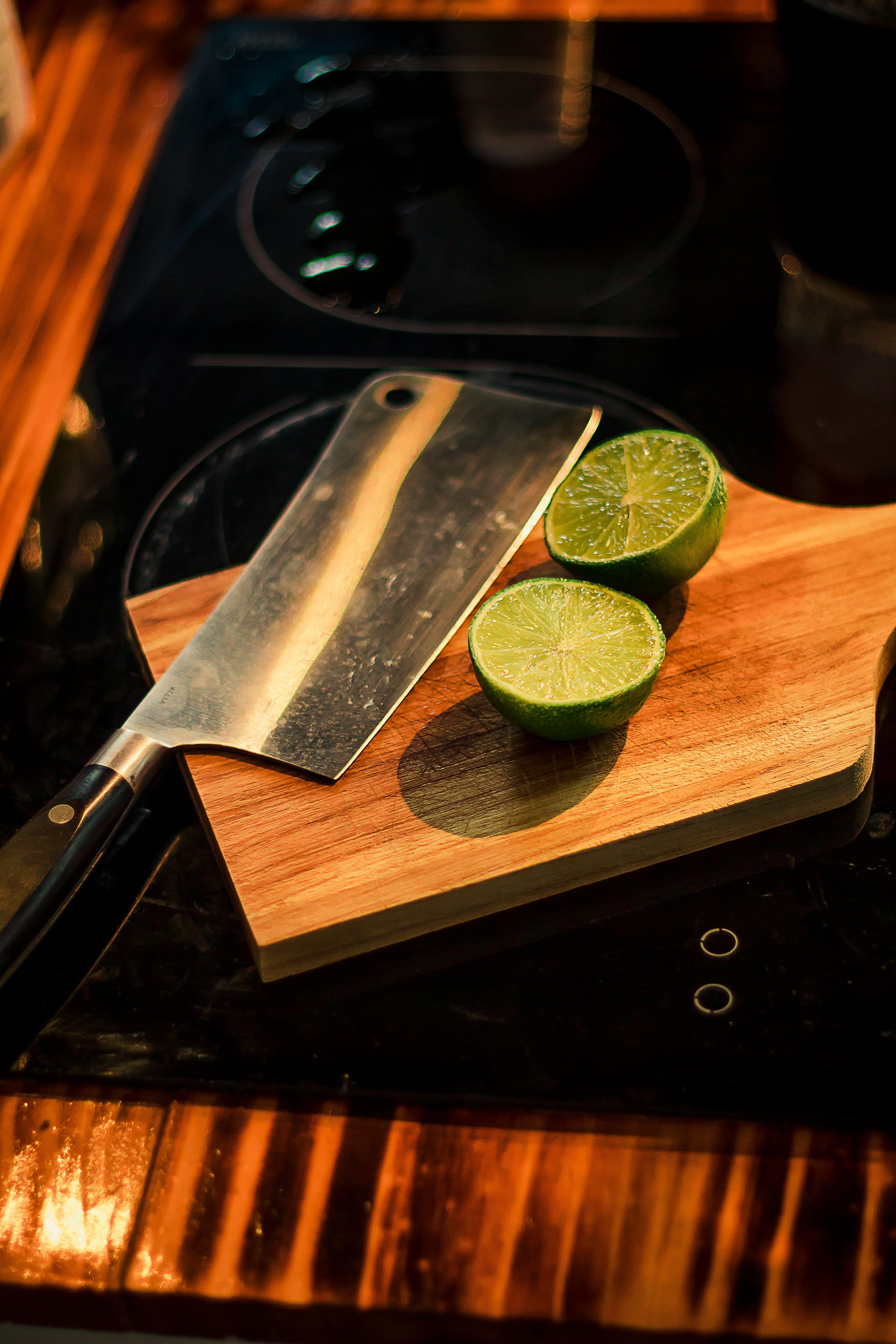 Sliced Lemons on Brown Wooden Chopping Board