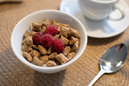 Bowl of Cereals with Raspberries
