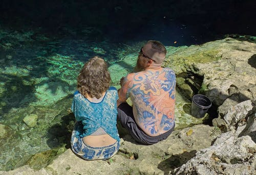 Free stock photo of backside, blue water, cenote, couple