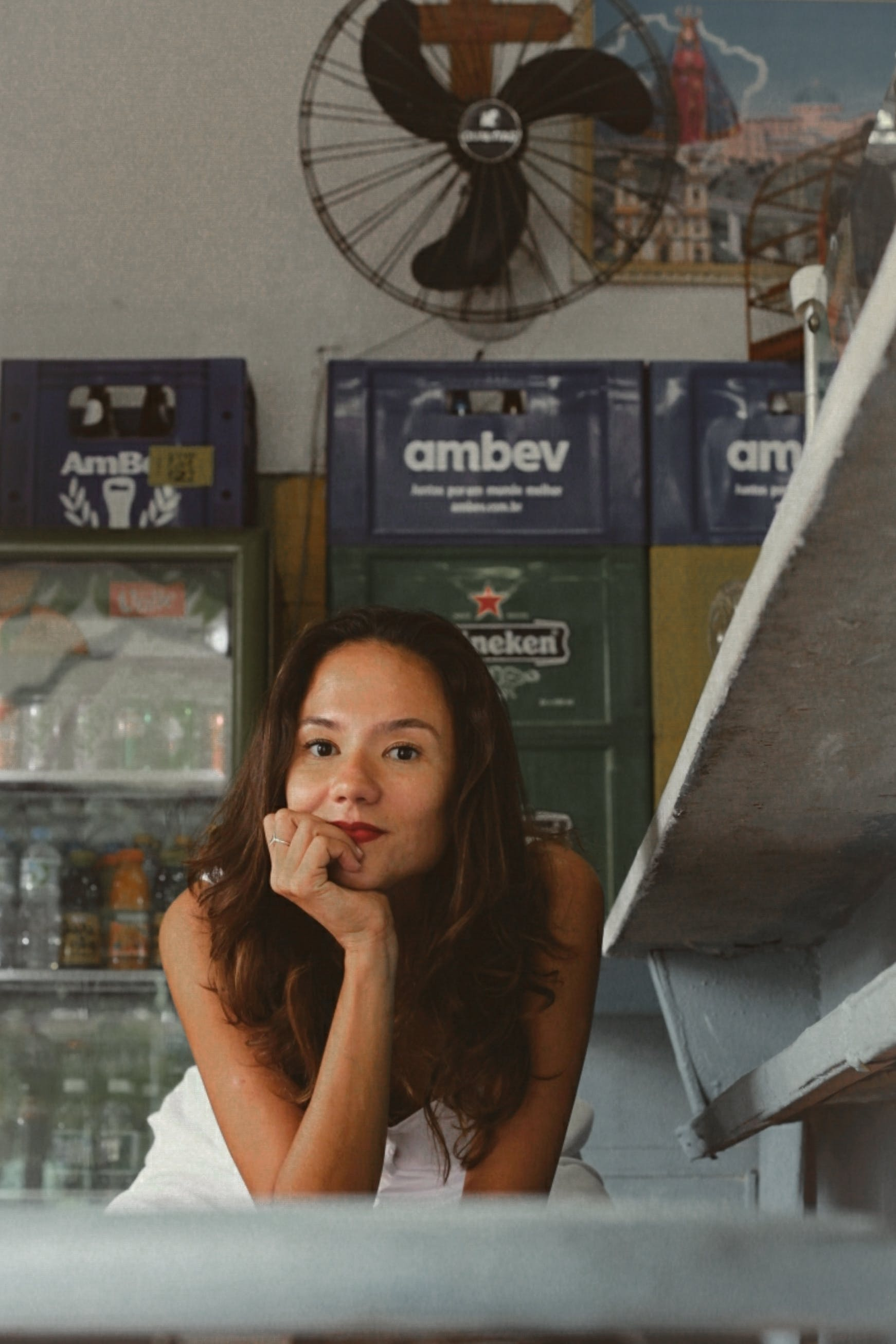 Photo Of Woman In Front Of An Industrial Cooler
