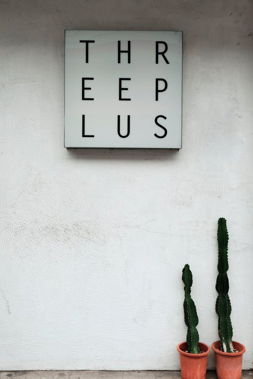 Threeplus Signboard on Wall