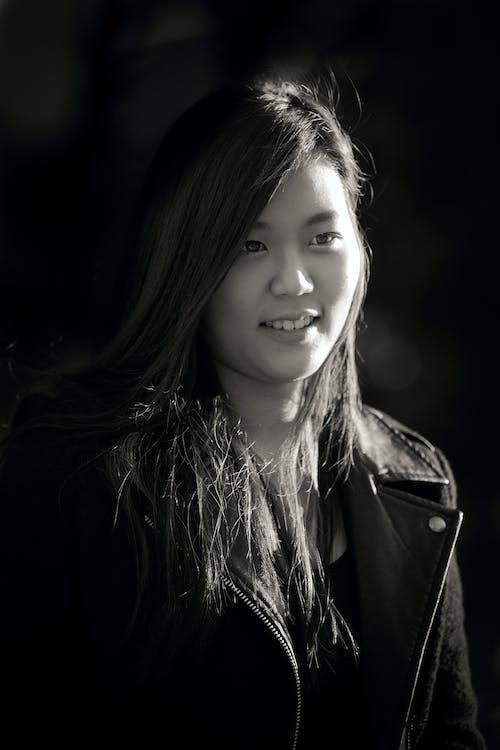 Free stock photo of Asian, asian woman, black and white, black jacket