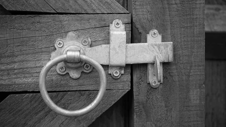 Grayscale Photo of Door Knock