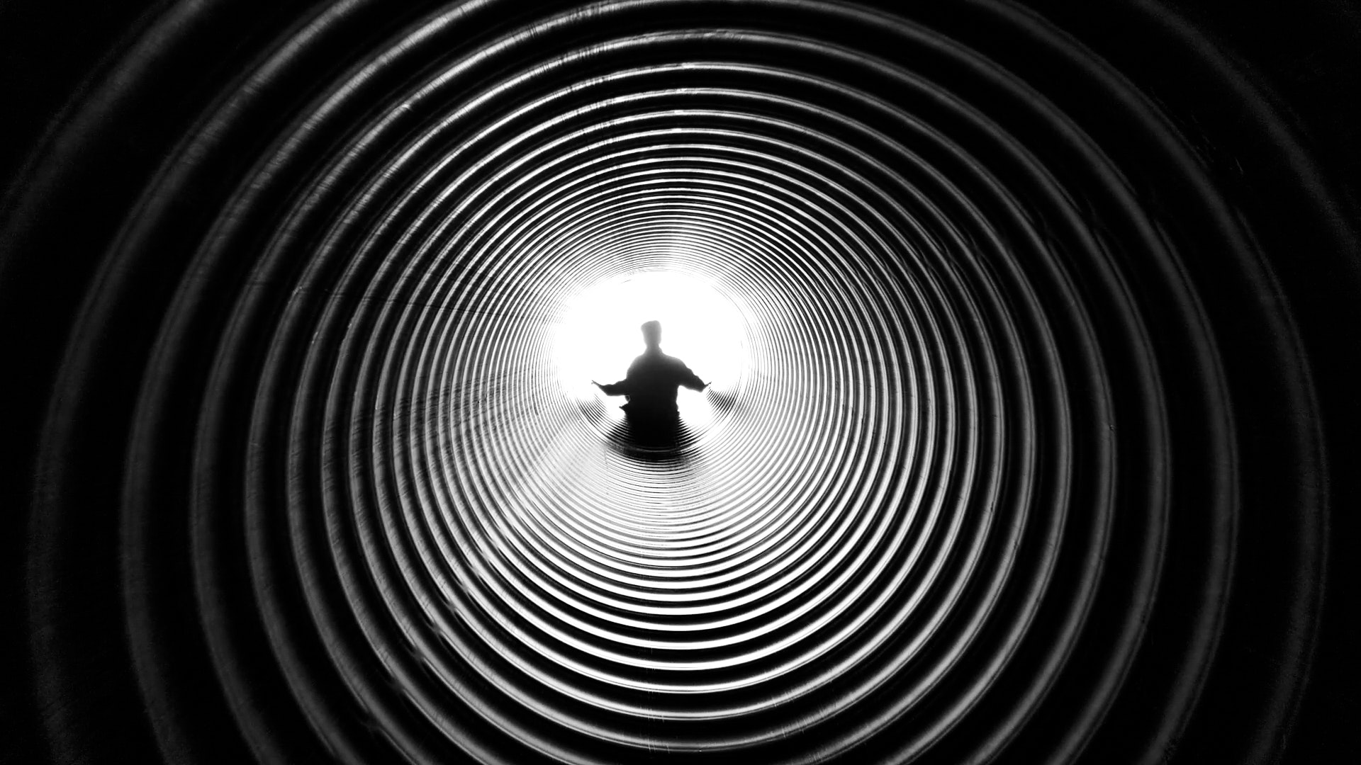 Grayscale photography of person at the end of tunnel anthony derosa