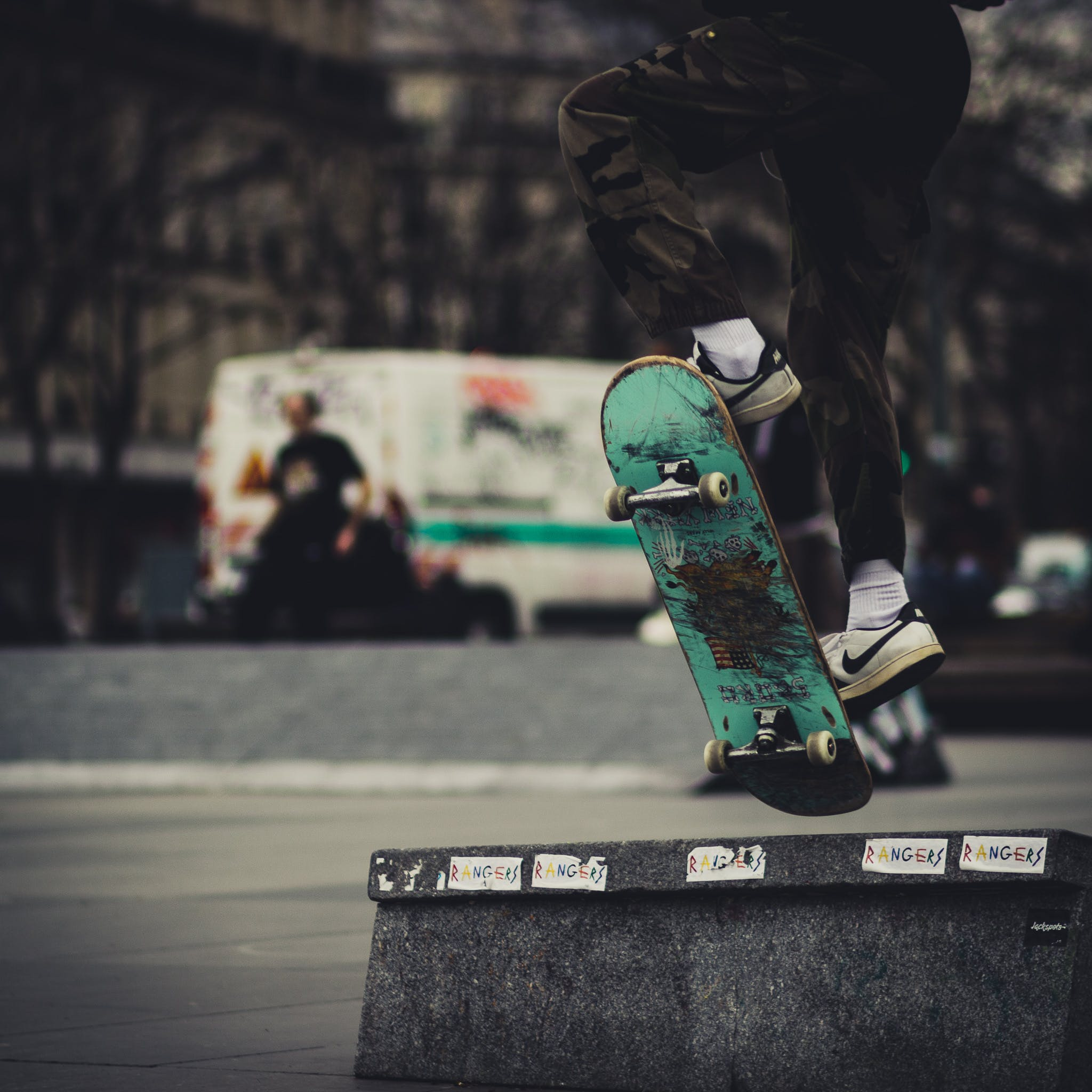 Close-up Photo of Person Skateboarding