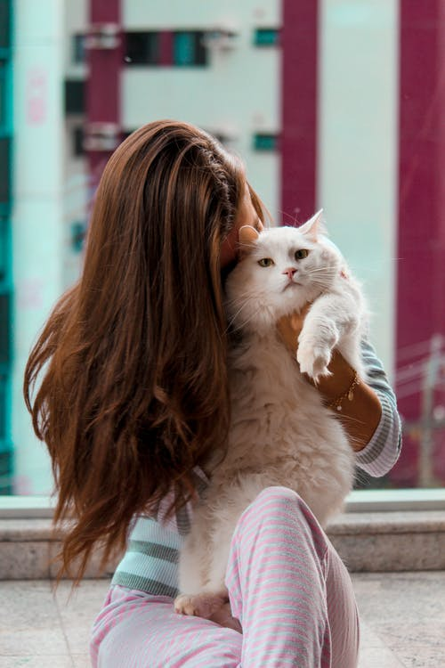 Woman Carryiing Cat