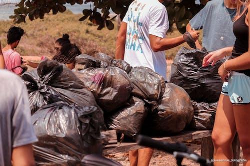 People Near Garbage Bags