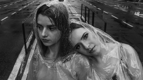 Monochrome Photo of Women Wearing Clear Raincoat