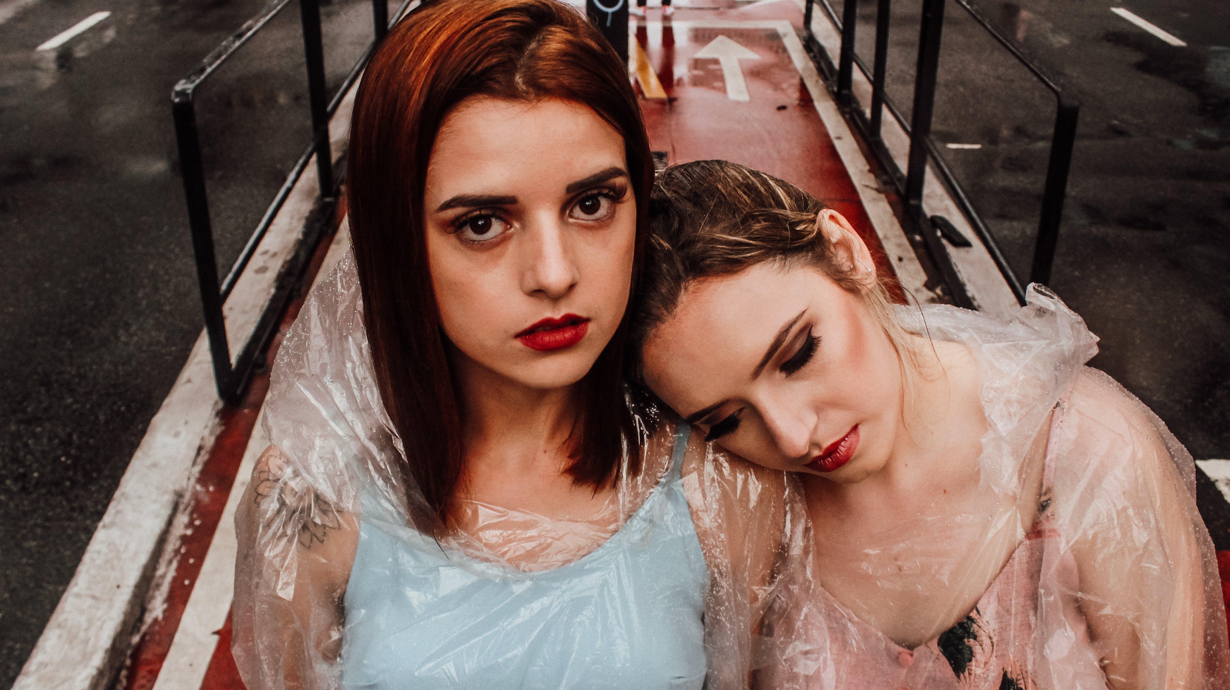 Photo of Women Wearing Clear Raincoat