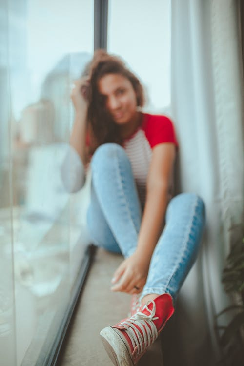 Photo of Girl Wearing Red Shoes