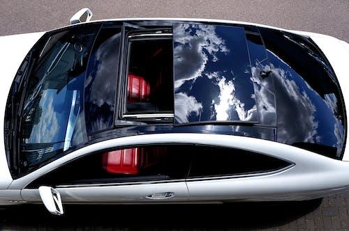 Ảnh lưu trữ miễn phí về c63 amg coupe, cửa sổ trời, ghế da, mái kính